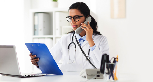 Medical practice receptionist on phone call