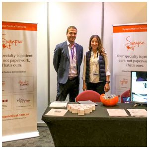 Thom and Amanda at Synapse booth attending the 15th National Regional Health Conference